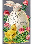 A vintage Easter postcard of a chick looking at a rabbit hatching from an egg