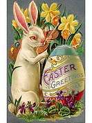 A vintage Easter postcard of a rabbit painting an egg (thumbnail)