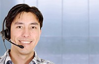 friendly customer service man smiling in an office environment