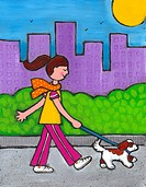 A woman walking her dog