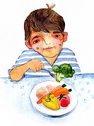 Young boy eating plate of vegetables