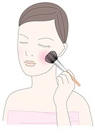 Young woman using make-up brush (thumbnail)