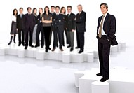 business leadership and teamwork with a businessman in front of a business team all standing on puzzle pieces
