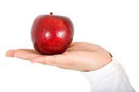 hand holding an apple isolated over a white background