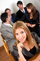 business team during a meeting in an office _ woman leading