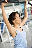 Woman exercising with the machines at the gym
