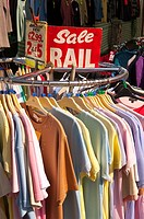 T shirts on a sale rail for sale on an outdoor market stall in Diss,Norfolk,Uk