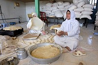 Women making bread in a traditional Baker's shop, Iran