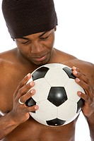Man staring at a football isolated over white