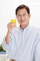 Husband, Man holding a glass of juice and smiling at the camera