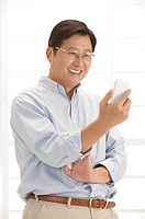Husband, Man holding mobile phone and smiling
