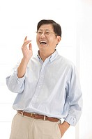 Husband, Man standing with hands in pocket and laughing