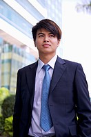 Young businessman looking away with anticipation (thumbnail)