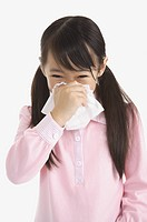 Little girl blowing nose with tissue (thumbnail)
