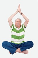 Domestic Life, a senior man making lotus position with eyes closed