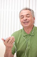 Domestic Life, a senior man listening music with eyes closed and smiling