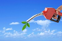 Lohas, Environmental Conservation, Digitally generated image of human hand holding a fuel pump with a green leaf on the outlet
