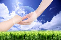 Lohas, Environmental Conservation, Digitally generated image of human hand holding baby's hand with grass and blue sky in background