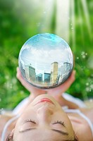 Lohas, Environmental Conservation, Digitally generated image of woman hands holding a sphere with buildings in it