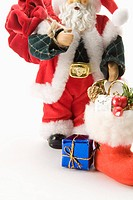 Figurine of Santa Claus, carrying gifts and a bag