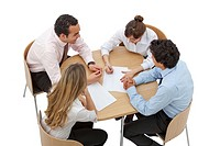 Business people working around a table isolated