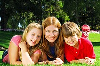 Portrait of a family _ mother and children _ relaxing in summer park