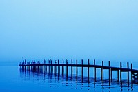 Early morning fog surrounds a dock.