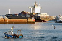 TRAWLER ENTERING THE PORT IN FRONT OF A CONTAINER SHIP, COMMERCIAL PORT, LE HAVRE, SEINE_MARITIME 76, NORMANDY, FRANCE