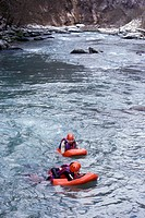 RESCUE WORKERS ON RIVER BOARDS ON THE RAPIDS OF THE DRANSE, HAUTE_SAVOIE 74, FRANCE