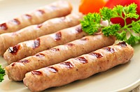 Serving of grilled breakfast sausages on a plate