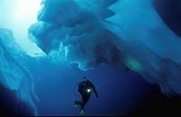 Ice Diving in Mountain Lake, Switzerland