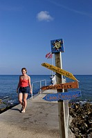 Jetty and colored Signs, Caribbean Sea, Cayman Islands