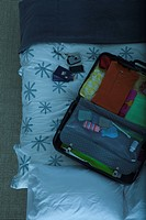 Packed suitcase lying open on bed