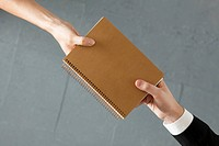 Handing colleague notebook