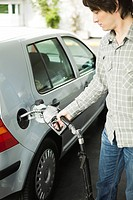 Man refueling car at gas station