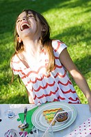 Girl with plate of sweets laughing