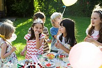 Children eating sweets at birthday party