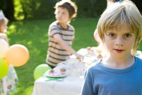 Boy at outdoor party, portrait
