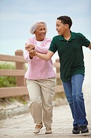 African American grandmother and grandson running