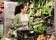 Hispanic woman shopping for fresh vegetables