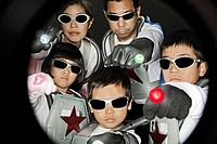 Asian family in superhero costumes