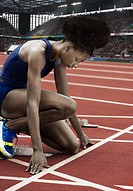 Runner at starting line in stadium (thumbnail)