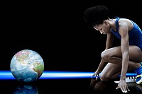 Female athlete and globe