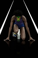 Athlete with jamaican flag face paint
