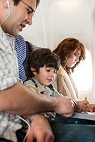 Boy and parents on airplane