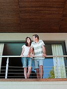 Couple on balcony of holiday home