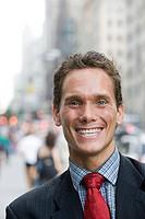 Portrait of businessman in street