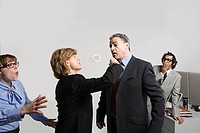 Businesswoman punching businessman
