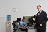 Boss pointing to businesspeople
