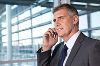 Businessman on cellphone in office